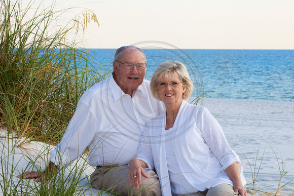snowbirds checking off portraits on the beach from their bucket list